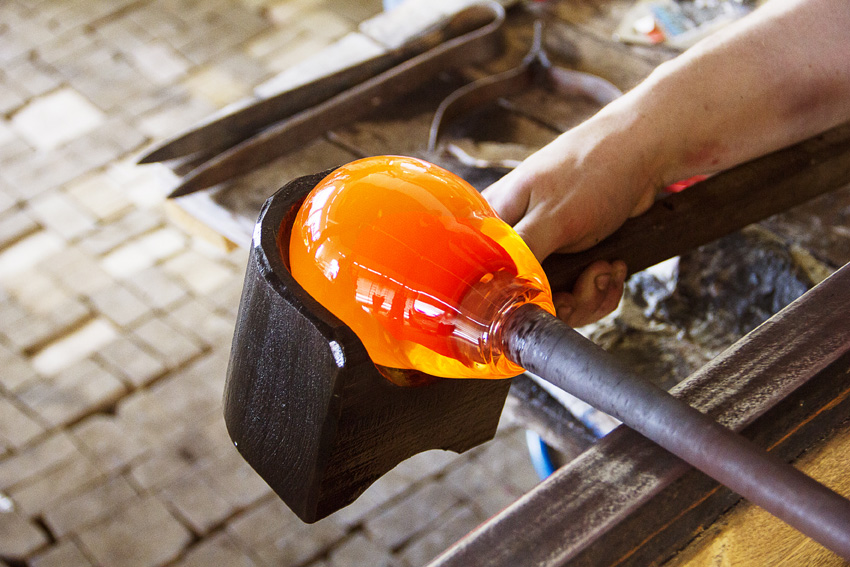 Shaping molten glass